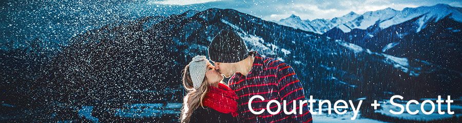 banff winter engagement photos snowy mountain couple kissing canmore