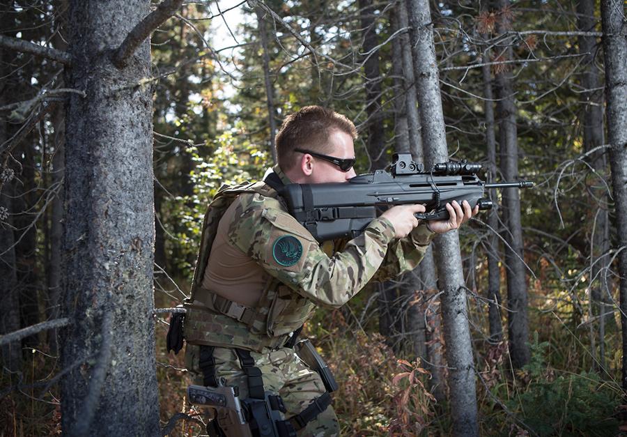 calgary portrait session anna michalska guns gear camo shooting range