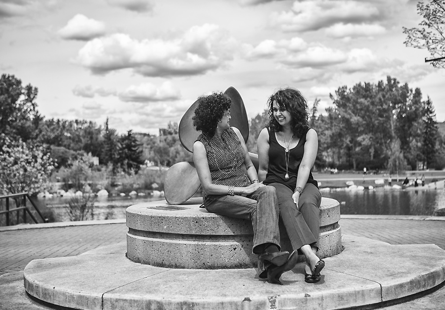 mother daughter sitting by statue at prince's island park black and white