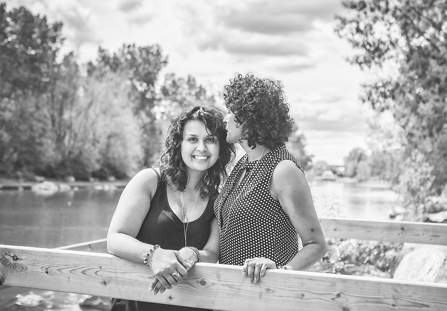 mother kissing daughter's head black and white portrait by river
