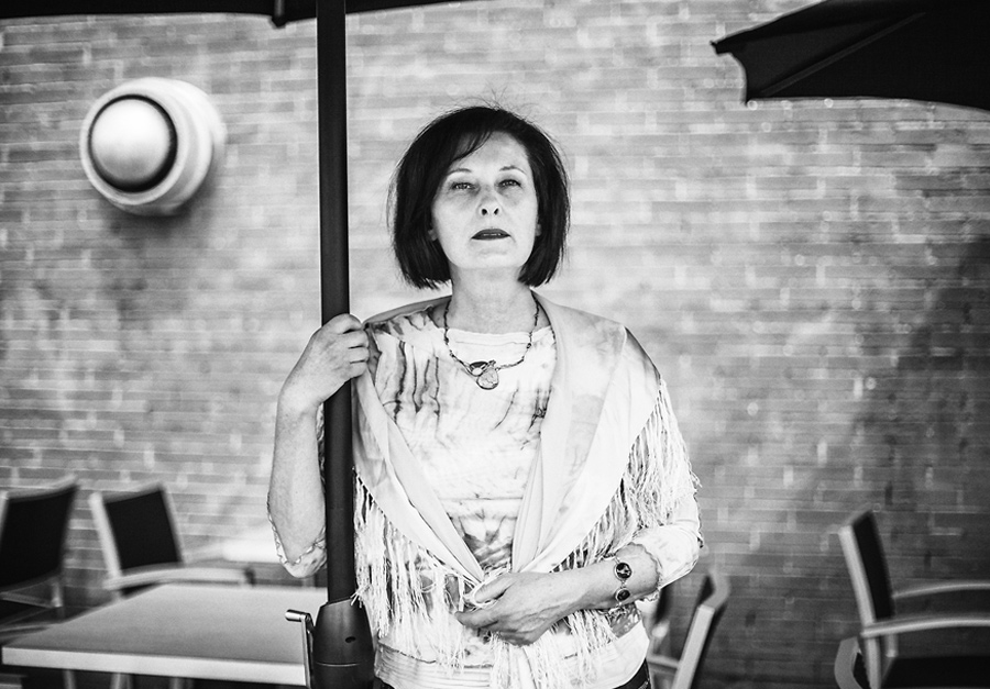 vendome cafe calgary portrait woman umbrellas portrait black white