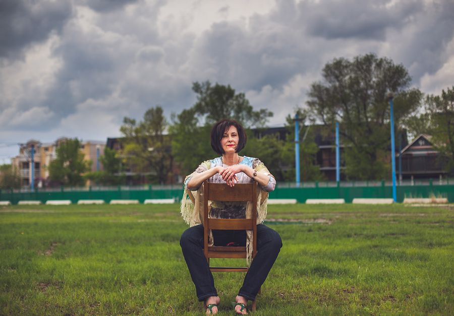 vendome cafe calgary portrait chair woman portrait stormy sky