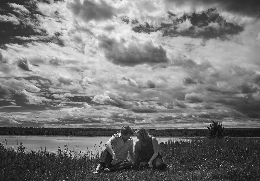 north glenmore park calgary couple sitting black and white