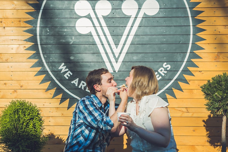 village ice cream couple eating ice cream engagement photos calgary