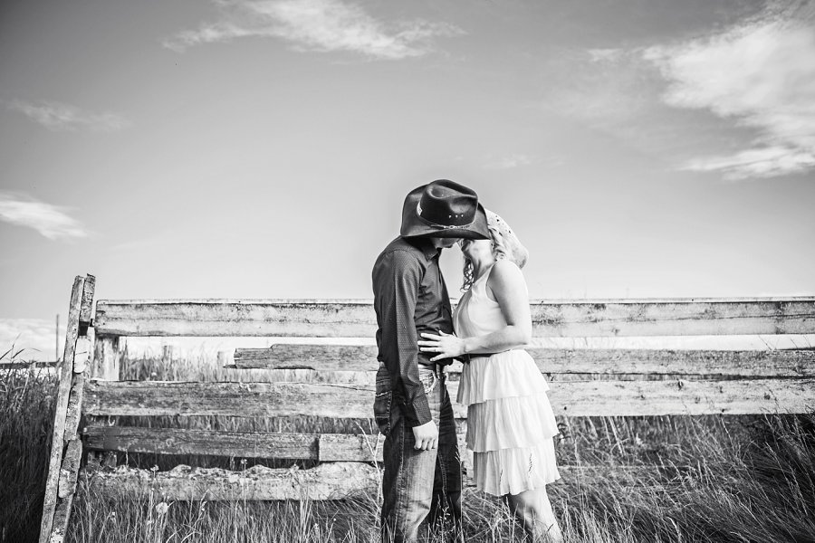 cowboy style couple kissing black and white calgary engagement session