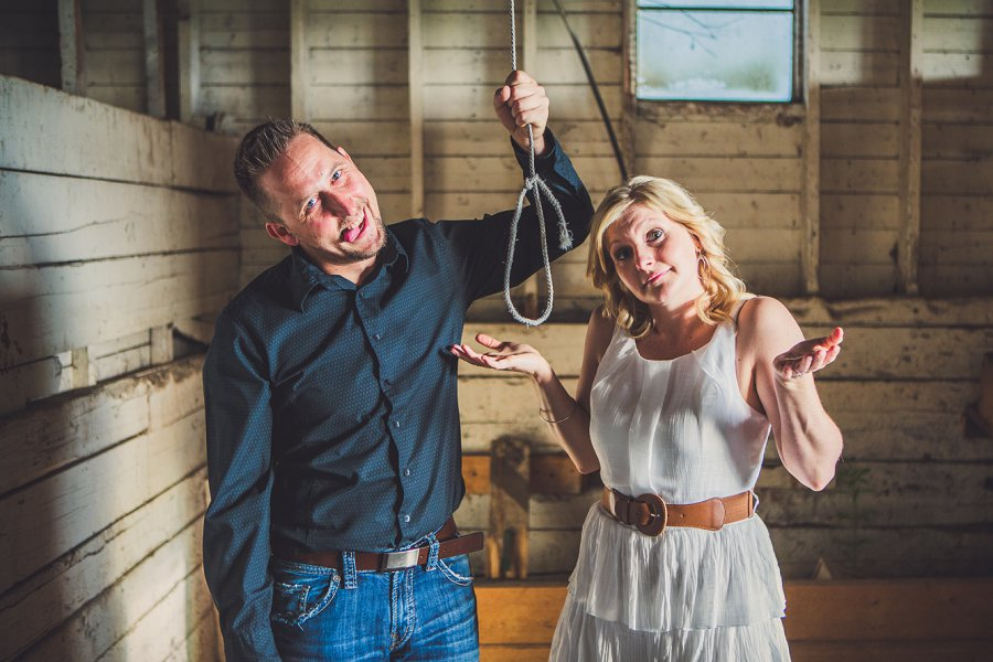 couple holding a noose cowboy style calgary engagement session
