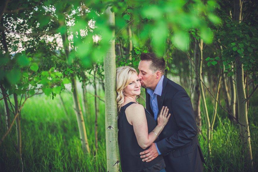 cowboy style couple man kissing woman on cheek calgary