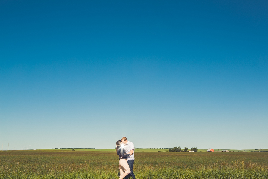 couple standing in front of big sky calgary rustic engagement session anna michalska