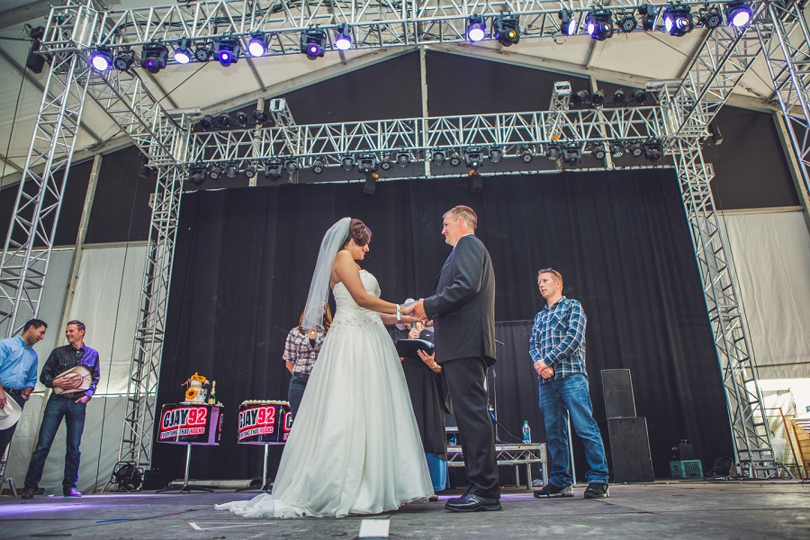 bride and groom on stage cowboys tent cowboys shotgun wedding stampede