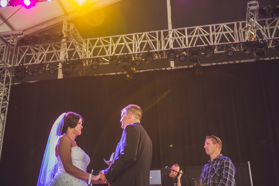 groom and bride get married on stage cowboys shotgun wedding