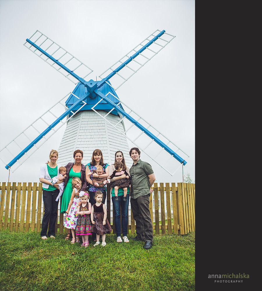 family with blue and white windmill heritage park family session calgary