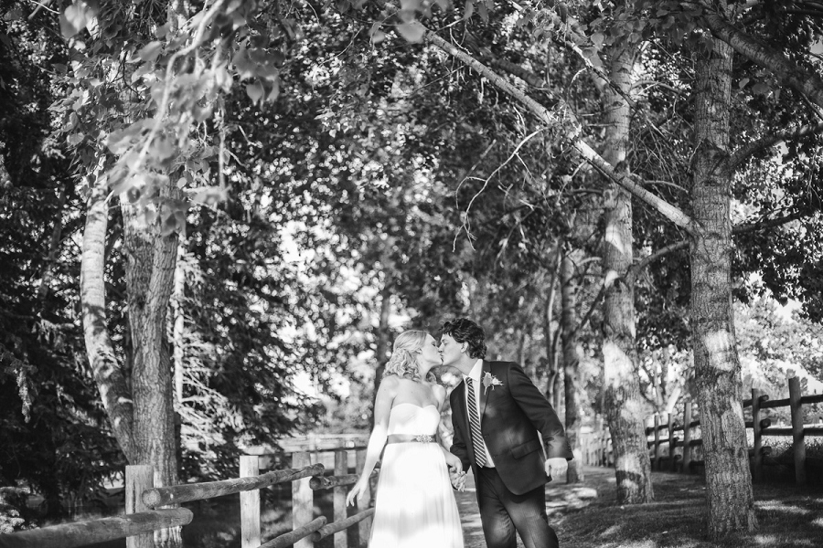 bride groom kiss with trees heritage park wedding calgary