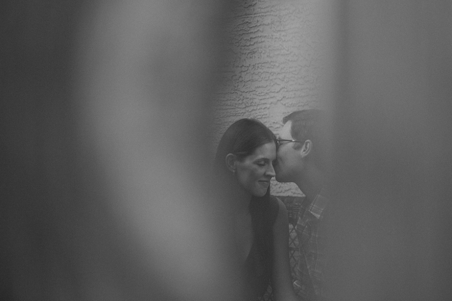 sneaky picture couple kissing calgary engagement session