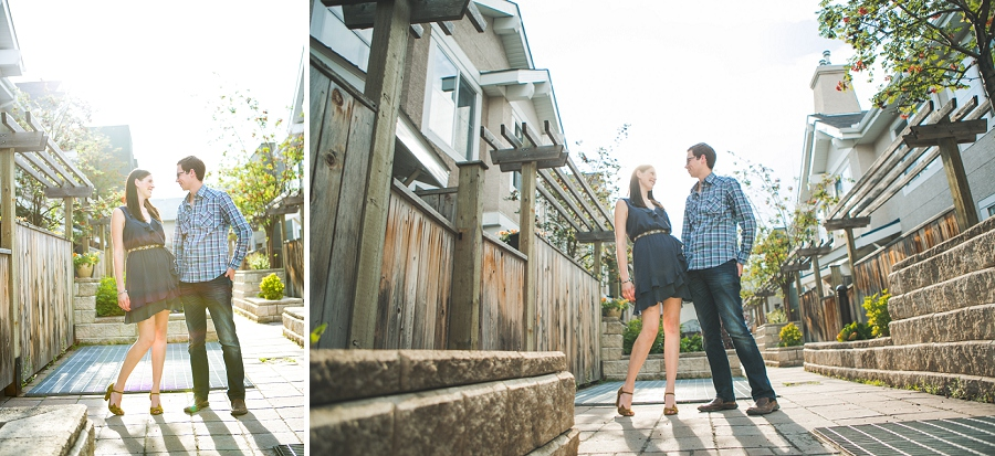 couple standing in front of home golden hour engagement session