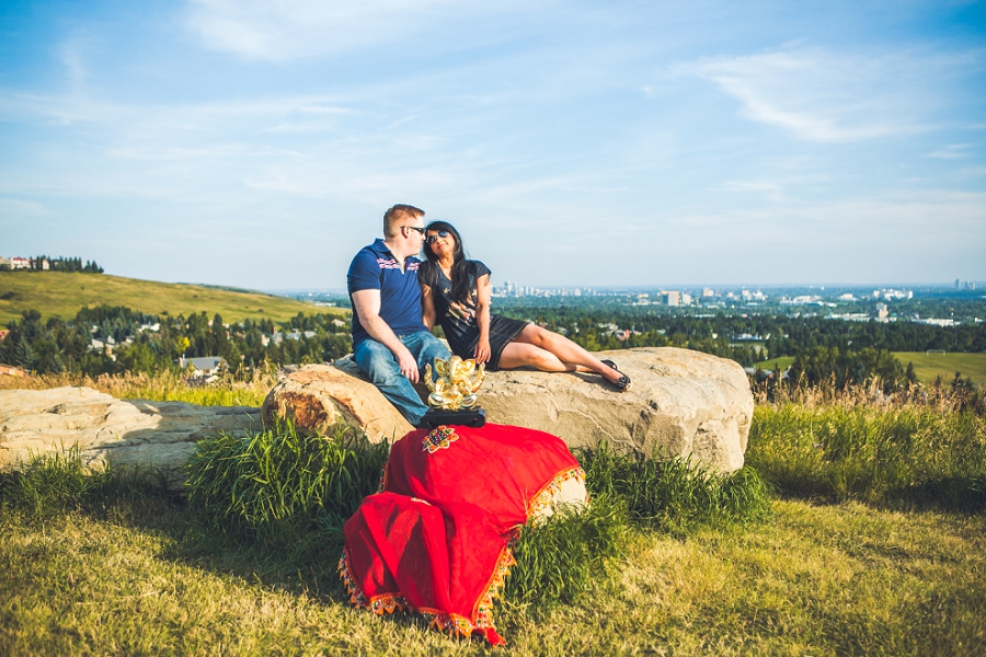 couple with ganesh sunset engagement session calgary