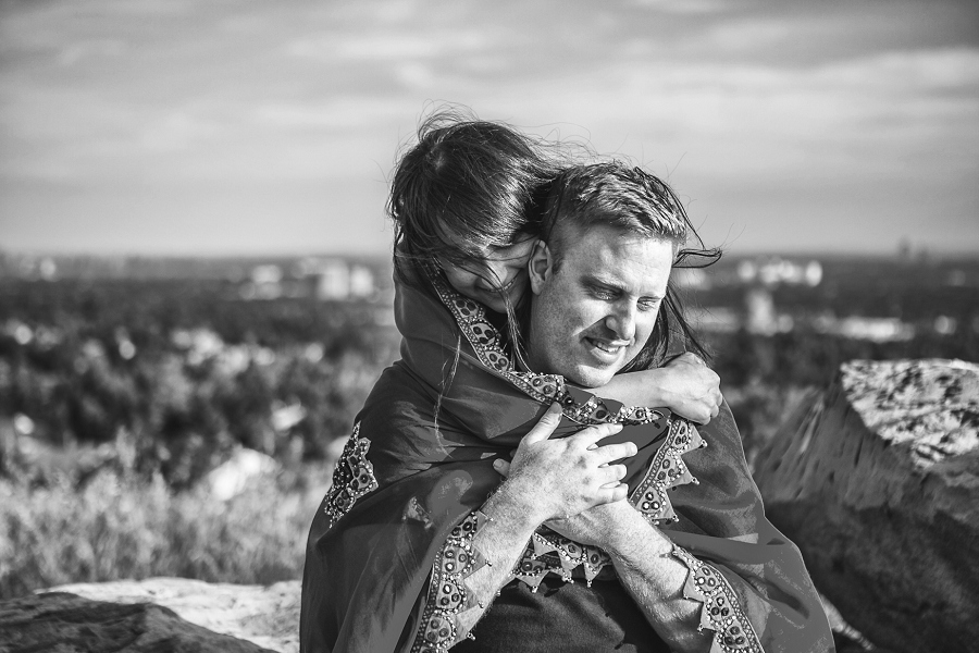 girl hugging boy sunset engagement session calgary black and white
