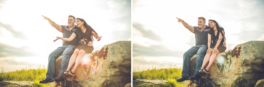 couple being silly sitting on a rock sunset engagement session calgary