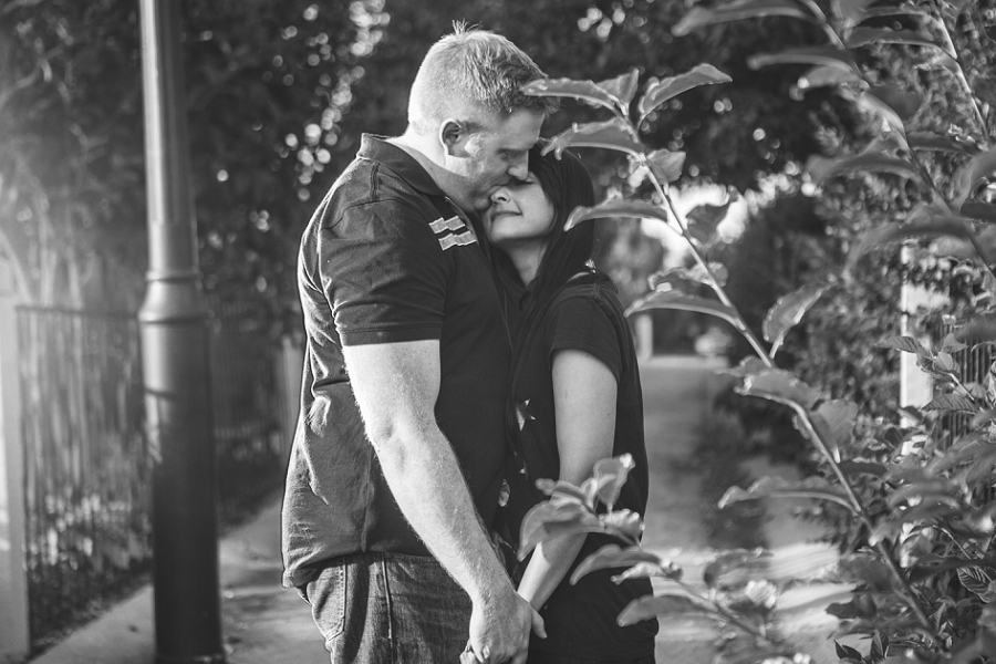 black and white engagement session girl and boy cuddle