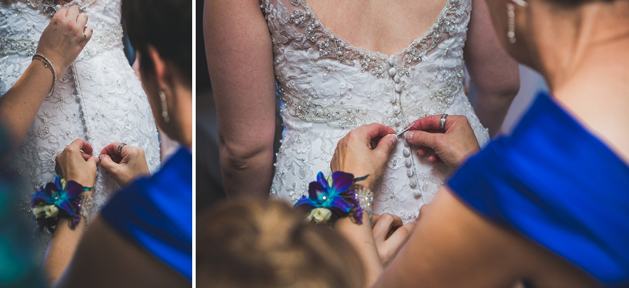 bride getting into wedding dress calgary photographer anna michalska peacock themed wedding