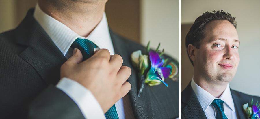 groom with peacock themed wedding details calgary wedding photographer anna michalska