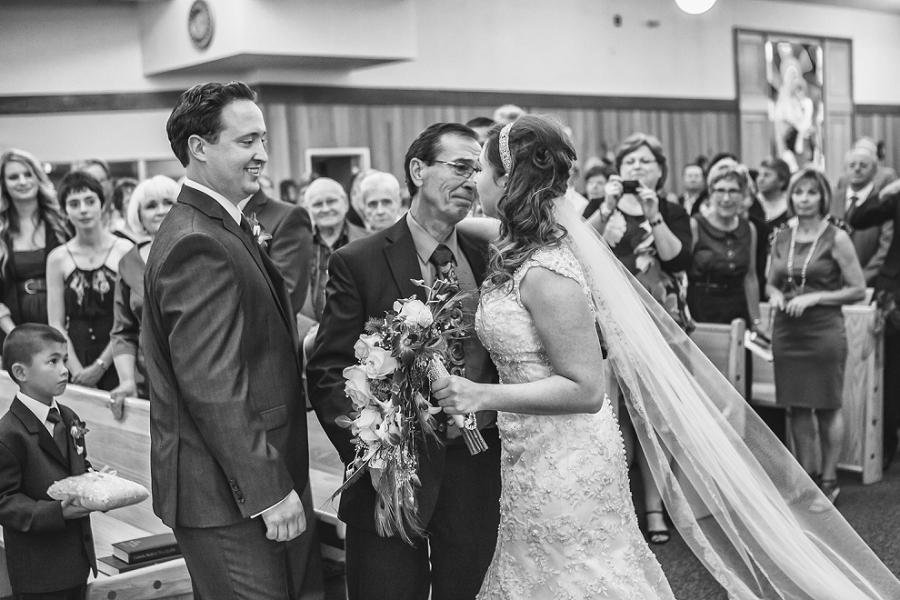 father giving bride away calgary wedding photographer anna michalska peacock themed wedding