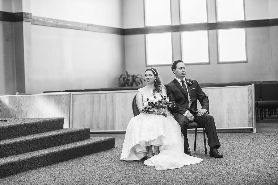 bride and groom wedding ceremony calgary photographer anna michalska peacock themed wedding