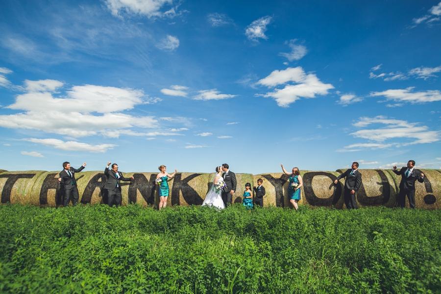 thank you on hay barrels calgary wedding photographer anna michalska peacock themed wedding