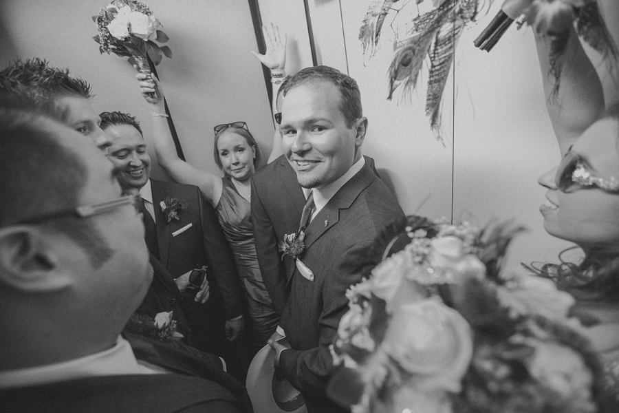 bridal party in elevator calgary wedding photographer anna michalska peacock themed wedding