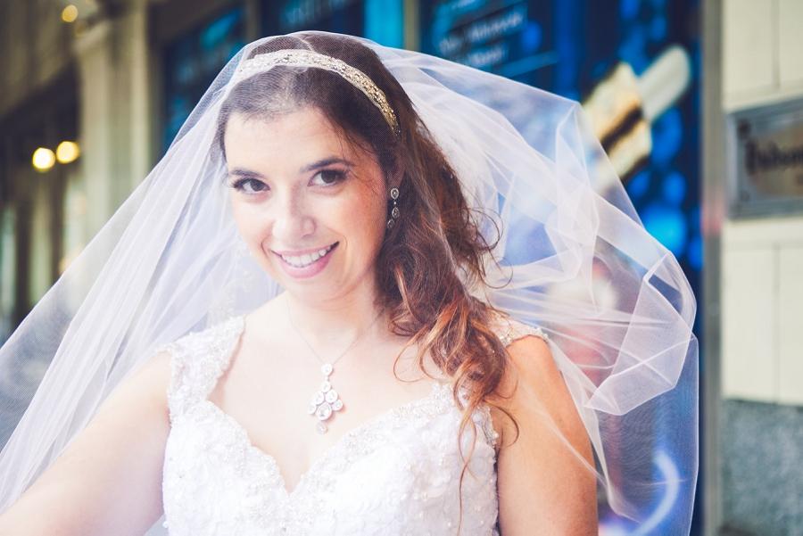 bride looking through veil calgary wedding photography the bay downtown anna michalska