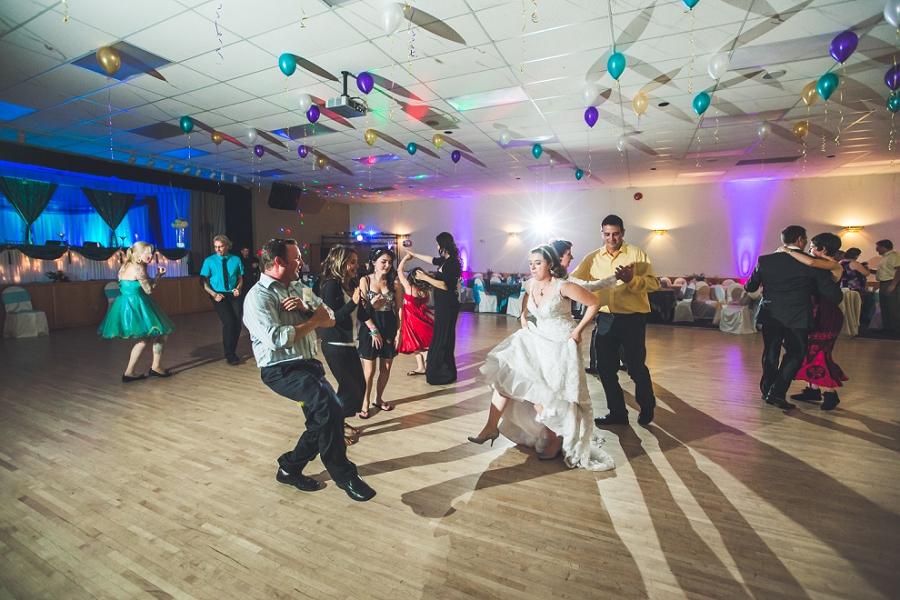 bride dancing with guests wedding reception calgary photographer anna michalska