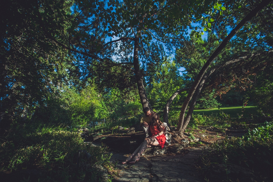 couple sitting large trees reader rock gardens calgary engagement session