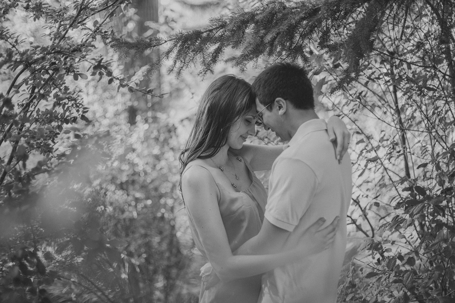 couple holding each other black and white reader rock gardens calgary engagement session