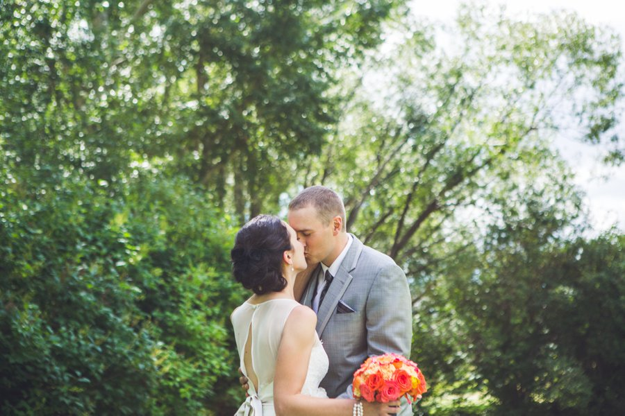 bride groom kiss first look confederation park calgary wedding photographers anna michalska
