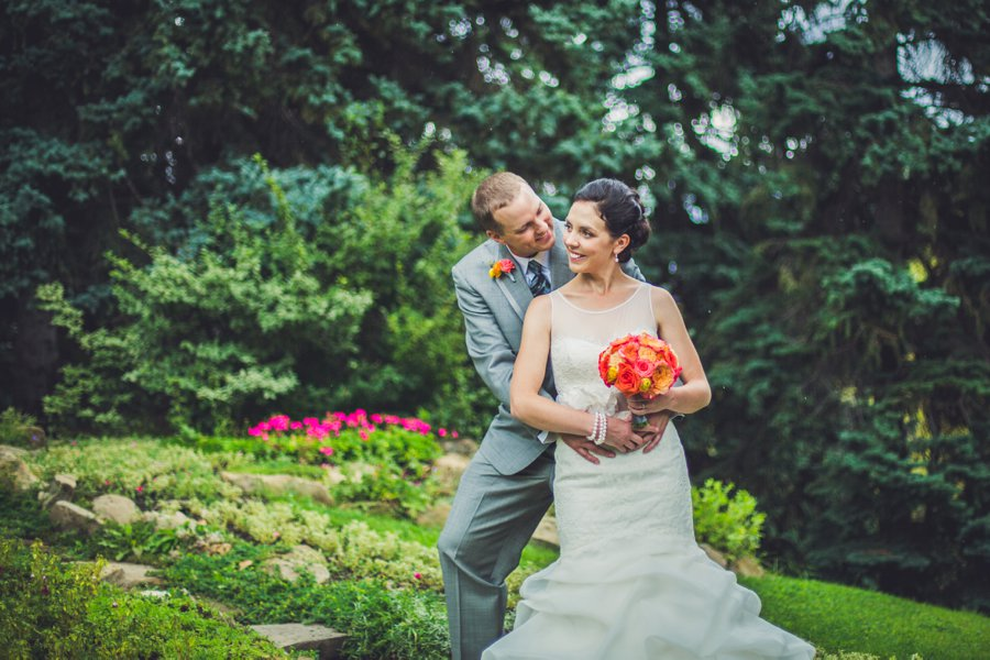 bride groom hugging riley park calgary wedding photographers anna michalska