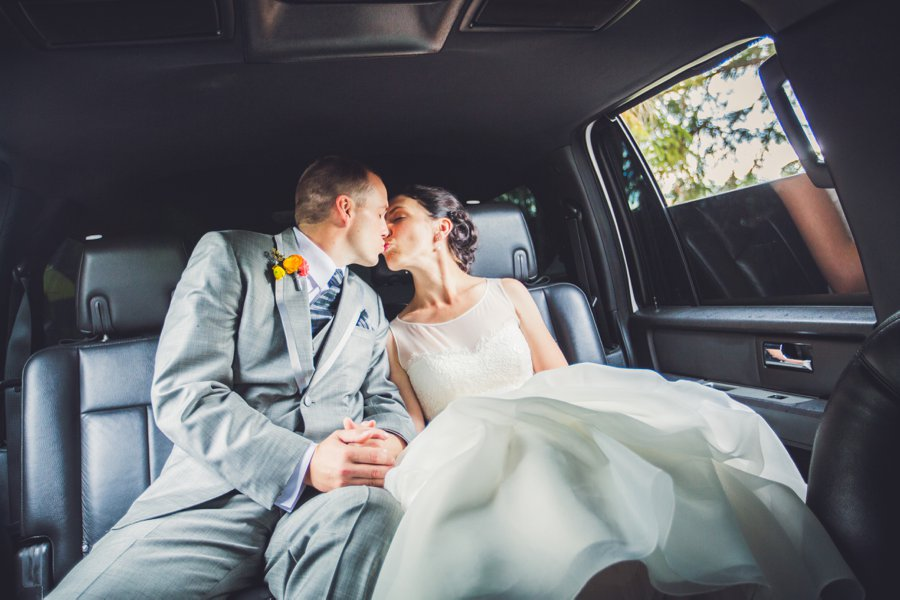 bride and groom kissing in limo riley park calgary wedding photographers anna michalska