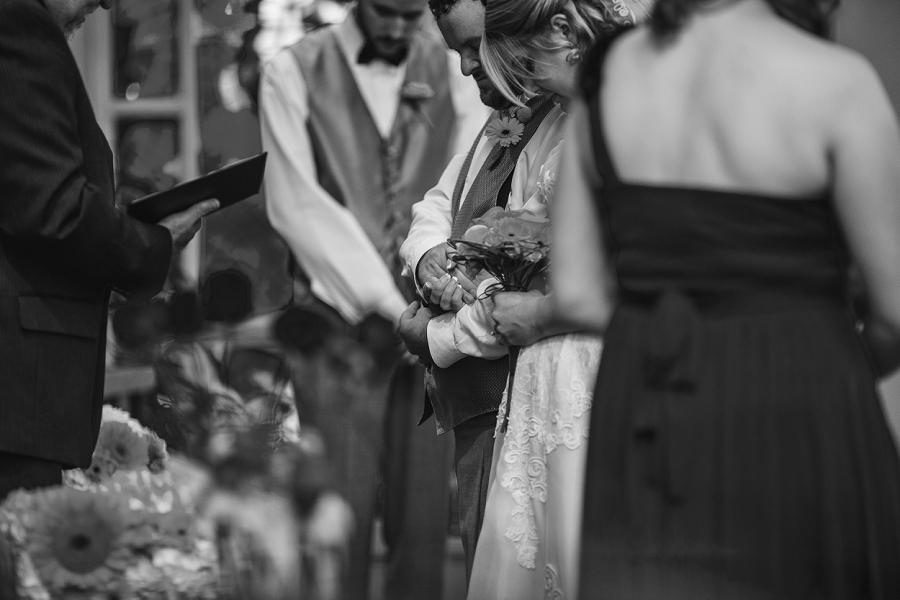 calgary wedding photographers bride and groom heads bowed