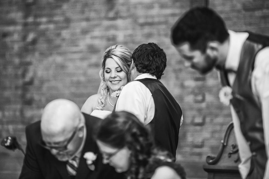 calgary wedding photographers groom kisses bride