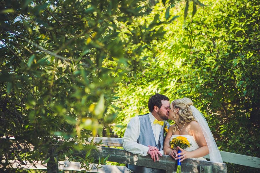 calgary wedding photographers confederation park bride groom kiss