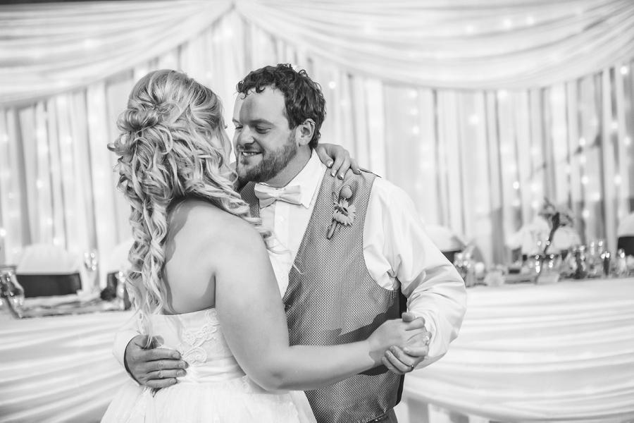 calgary wedding photographers groom smiling first dance
