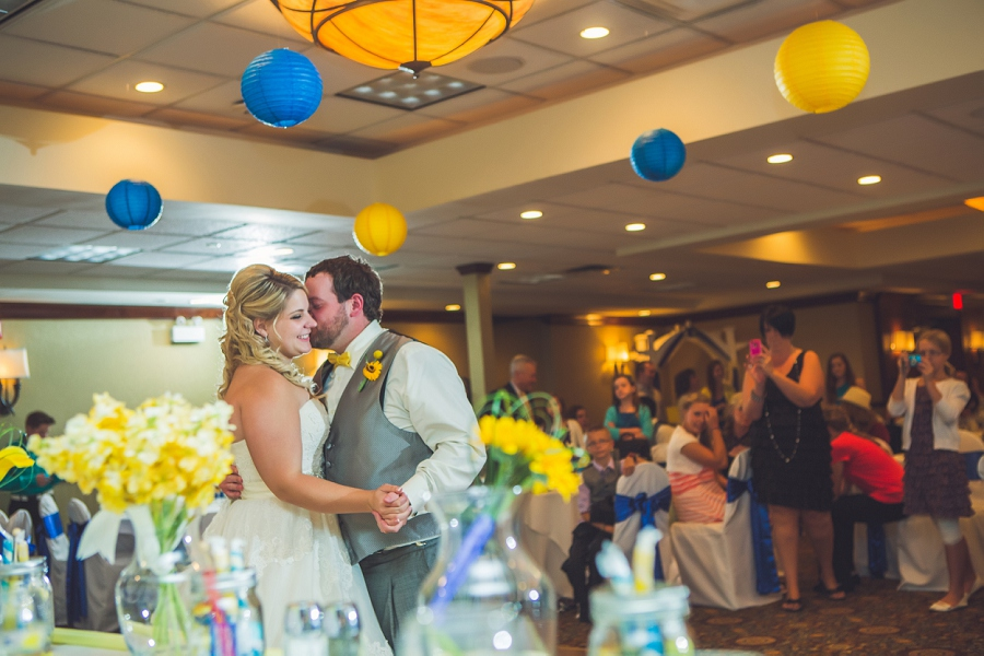 calgary wedding photographers groom kisses bride first dance