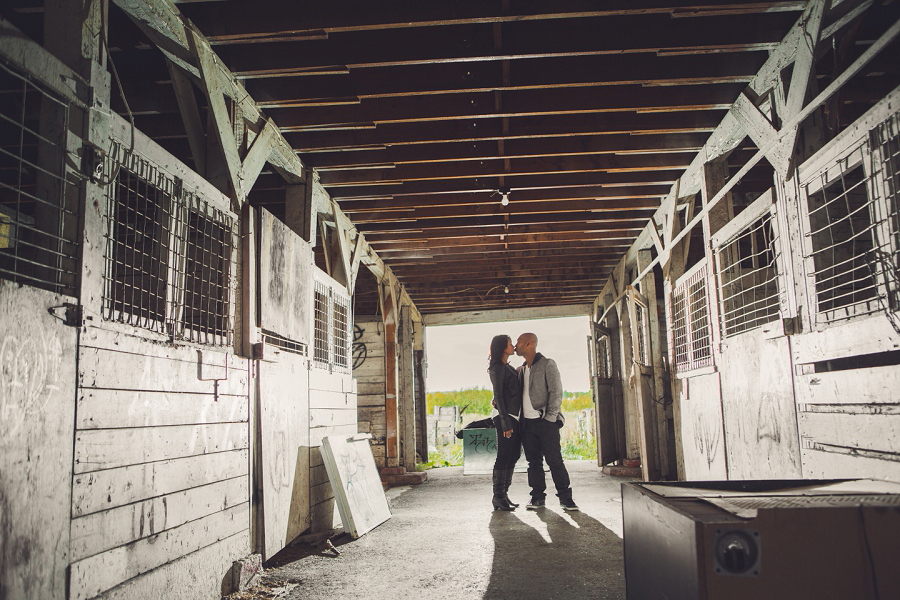 calgary cambodian engagement session bride groom kissing in barn rural