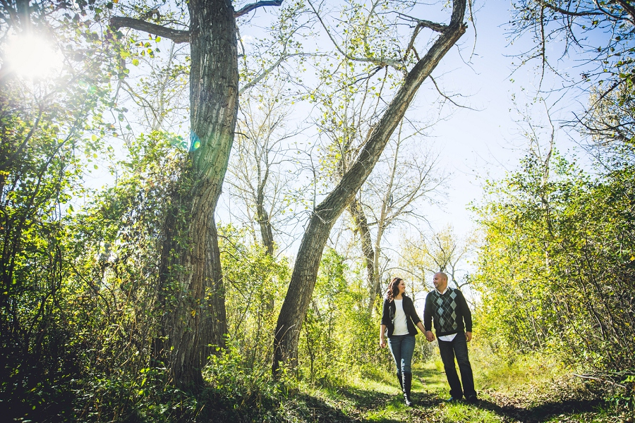 pincher creek calgary engagement photography anna michalska walking bride groom with fall leaves