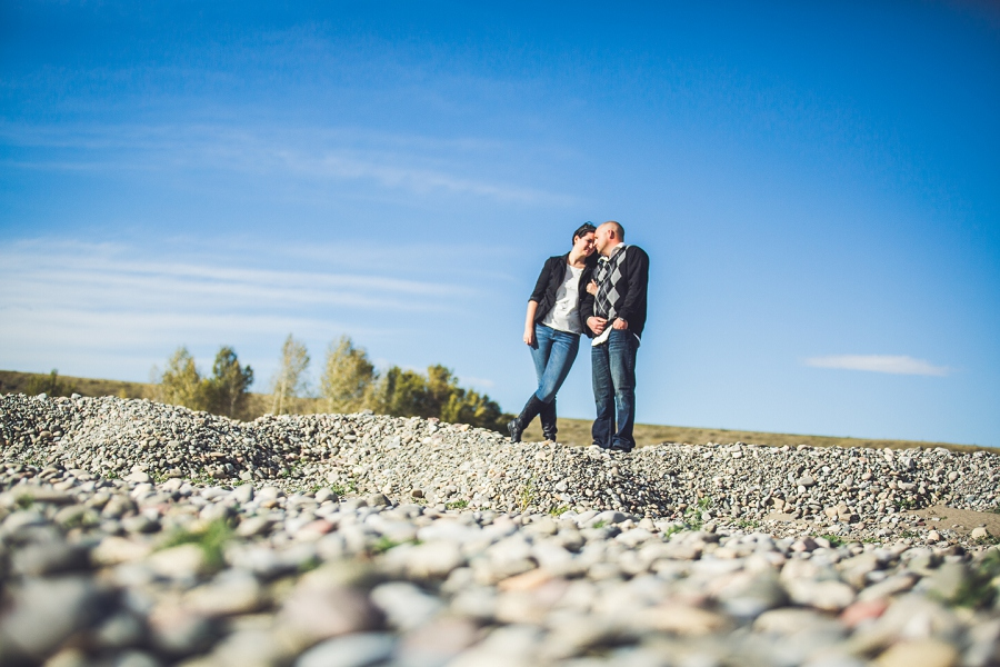 pincher creek calgary engagement photography anna michalska bride groom on water rocks