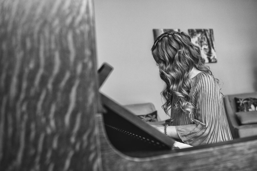 calgary family photographer young girl playing on piano