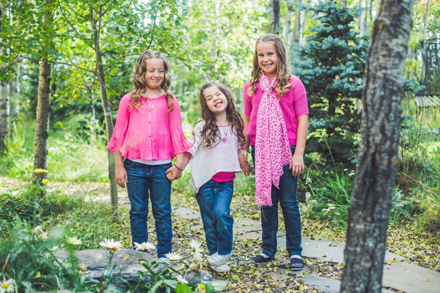 calgary family photographer sisters daughters fall portrait