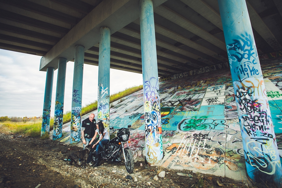 calgary biker couple engagement session photographer graffiti bike bridge dog