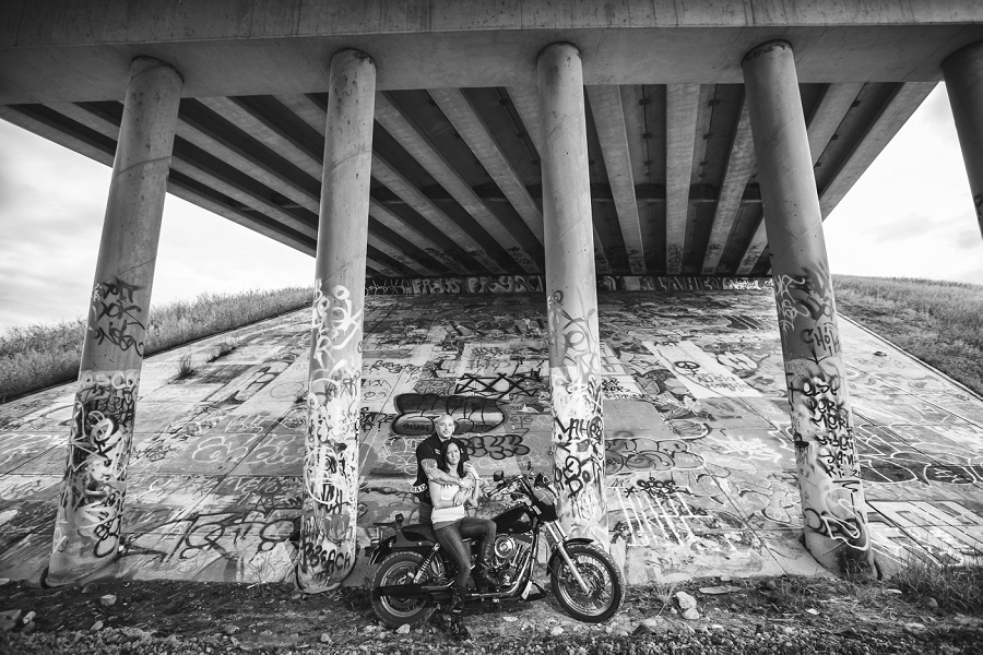 calgary biker couple engagement session photographer bridge graffiti bike dog