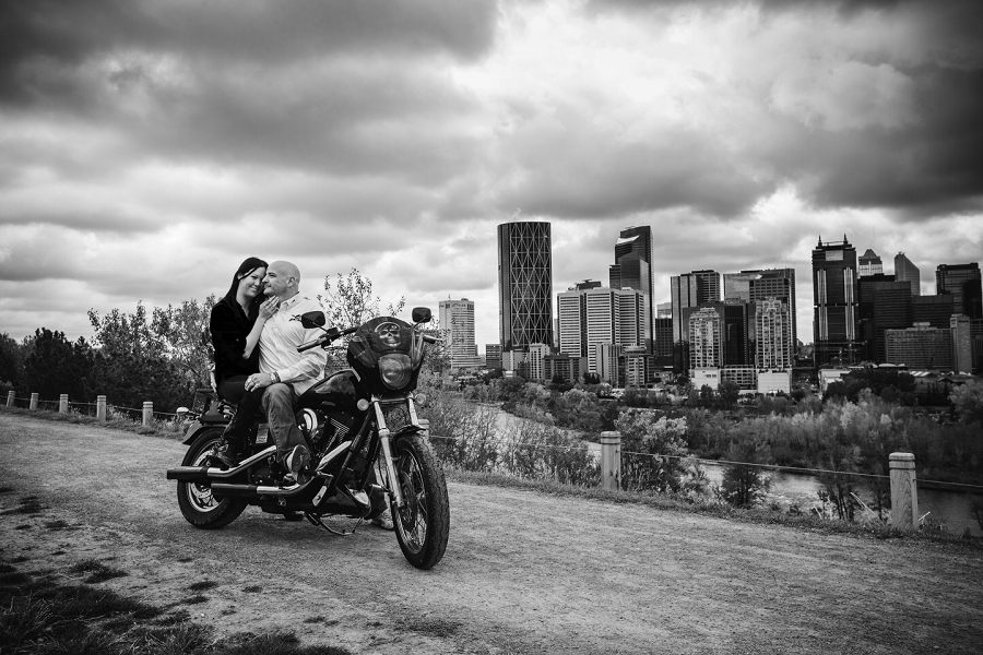 calgary biker couple engagement session photographer crescent heights downtown skyline