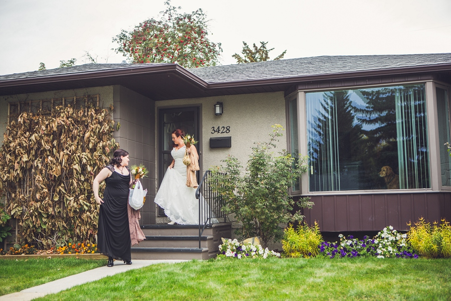 bride bridesmaid leaving house calgary steampunk wedding photographer anna michalska