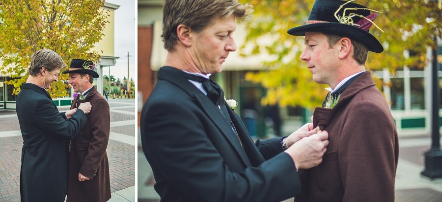 groomsman pinning on boutonniere for groom calgary steampunk wedding photographer anna michalska